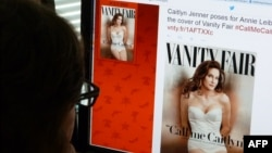A journalist looks at Vanity Fair's Twitter site with the Tweet about Caitlyn Jenner, the transgender Olympic champion formerly known as Bruce, who will be featured on the July cover of the magazine, June 1, 2015.