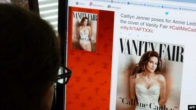 FILE - A journalist looks at Vanity Fair's Twitter site with the Tweet about Caitlyn Jenner, the transgender Olympic champion formerly known as Bruce, featured on the July 2015 cover of the magazine.