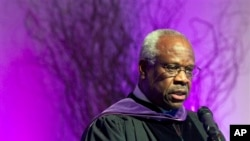 In this Jan. 26, 2012 file photo, Supreme Court Justice Clarence Thomas speaks at College of the Holy Cross in Worcester, Mass. Thomas has asked questions during Supreme Court arguments for the first time in 10 years. Thomas' question came Monday, Feb. 29, 2016. (AP Photo/Michael Dwyer, File)