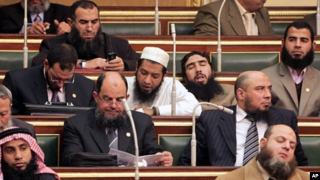 Salafi members of parliament are seen during the first Egyptian parliament session, after a revolution ousted former President Hosni Mubarak, in Cairo, January 23, 2012