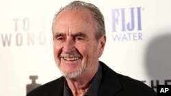 "FILE - Wes Craven arrives at the premiere of ""To The Wonder,"" April 9, 2013, in Los Angeles."