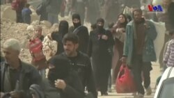 Binlerce Kişi Doğu Guta'yı Terkediyor
