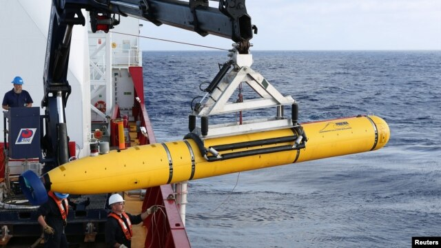 Crew aboard the Australian Defense Vessel Ocean Shield move the U.S. Navy's Bluefin-21 autonomous underwater vehicle into position for deployment in the southern Indian Ocean to look for the missing Malaysia Airlines flight MH370, April 14, 2014 in this h