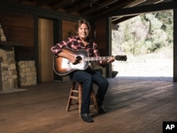 "Musician John Fogerty poses for a portrait during an interview about his new memoir ""Fortunate Son: My Life, My Music,"" in Topanga, California, Sept. 24, 2015."