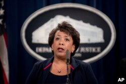 FILE - Attorney General Loretta Lynch speaks at a news conference, Sept. 22, 2016, at the Justice Department in Washington. The Justice Department is moving forward with its plans to collect data on how often law enforcement officers use force.