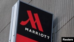 FILE - Signage for the New York Marriott Marquis is seen in Manhattan, New York, Nov. 16, 2015.