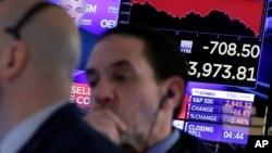 纽约股票交易所收盘前的交易商们。(2018年3月22日)