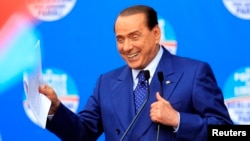 People of Freedom party member Silvio Berlusconi makes an address on stage in Brescia May 11, 2013.