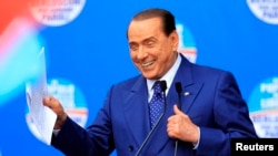 FILE - People of Freedom party member Silvio Berlusconi makes an address on stage in Brescia.