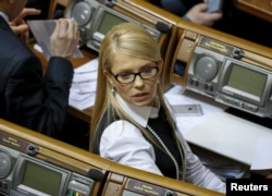 乌克兰前总理季莫申科出席议会会议。(2016年2月16日)