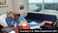 Secretary of State John Kerry speaks to National Security Adviser Susan Rice from his hospital room at Massachusetts General Hospital in Boston, June 9, 2015. The photo was released June 10, 2015.