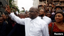 Felix Tshisekedi, chef du principal parti d'opposition congolais, l'Union pour la démocratie et le progrès social, annoncé vainqueur des élections présidentielles, avec à ses partisans à Kinshasa, en République démocratique du Congo, le 10 janvier 2019