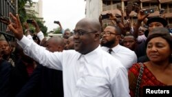 Felix Tshisekedi, leader of the Congolese main opposition party, the Union for Democracy and Social Progress who was announced as the winner of the presidential elections, gestures to his supporters in Kinshasa, Democratic Republic of Congo, Jan. 10, 2019.