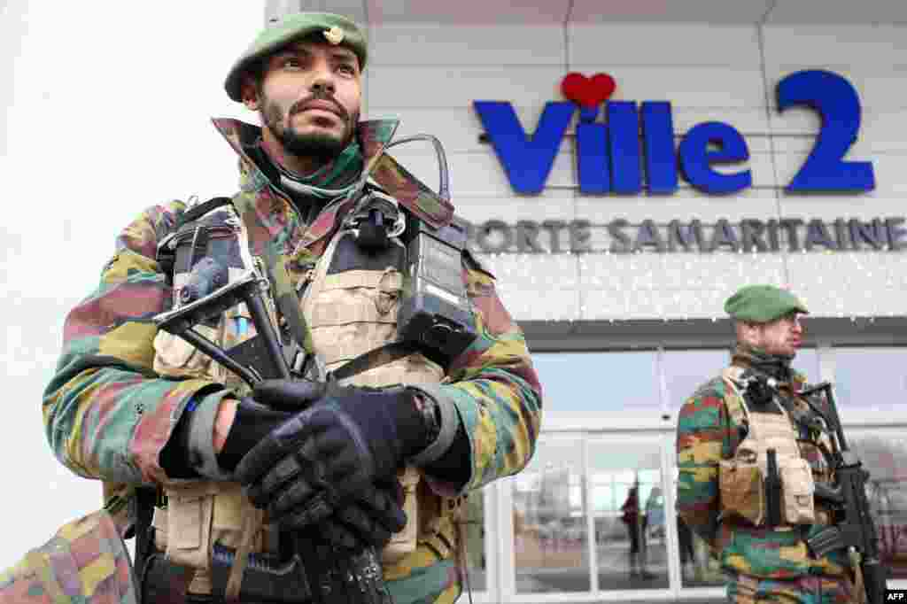 Belgian troops take position outside a commercial centre in Charleroi.