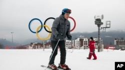 A visitor skis in front of the Olympic rings at the Rosa Khutor ski resort in Sochi, Russia, Jan. 12, 2018. Sochi hosted Olympic skiing in 2014, Russia.