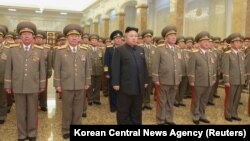 FILE - North Korean leader Kim Jong Un, center.