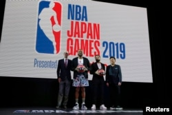 NBA Commissioner Adam Silver, Houston Rockets' P. J. Tucker, Toronto Raptors' Fred VanVleet and Rakuten, Inc. Chairman & CEO Mickey Mikitani, pose for a photo during a welcome reception for the NBA Japan Games 2019