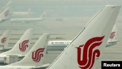 FILE - Air China planes are seen on the tarmac of the Beijing Capital International Airport, July 11, 2011.