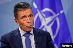 FILE - Secretary General Anders Fogh Rasmussen says NATO condemns Russia's 'continuing disregard' for Ukraine sovreignty.