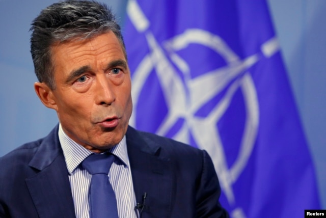 NATO Secretary General Anders Fogh Rasmussen speaks during an interview with Reuters at alliance headquarters in Brussels August 11, 2014.