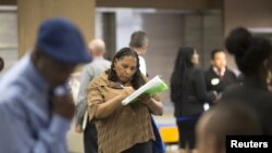 FILE - Malana Long fills out a job application during a job fair for the homeless at the Los Angeles Mission in the Skid Row area of Los Angeles, California, June 4, 2015. The number of people signing up for unemployment benefits in the United States fell to a 42-year low last week.