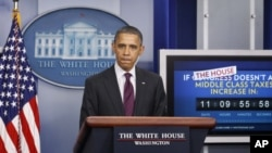 President Barack Obama speaks during the news briefing at the White House, Tuesday, Dec. 20, 2011, in Washington.