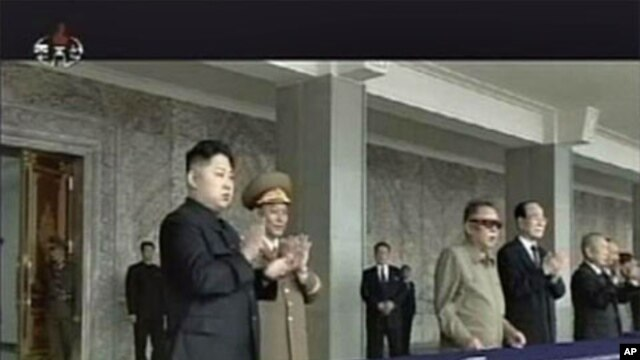 North Korean leader Kim Jong-Il (3rd R) and his son Kim Jong-un (L) watch a military parade in Pyongyang's central square, September 9, 2011.