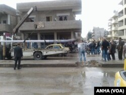 FILE - People in Qamishli, Syria, survey the damage from an explosion, April 11, 2016.