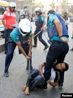 A policeman uses a baton on an activist of Jamaat-e-Islami, Bangladesh's biggest Islamist party, during a clash at Jatrabari in Dhaka, Feb. 28, 2013.