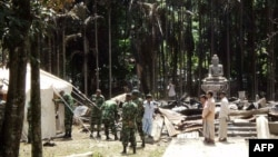 Soldiers from the Bangladesh Army erect tents at the torched Lal Ching Buddhist temple at Ramu, some 350 kilometers from the capital Dhaka, October 1, 2012.