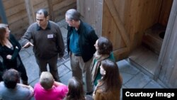 A group of visitors enjoys a tour of the Lower East Side Tenement Museum