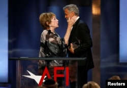 Actor George Clooney accepts the 46th AFI Life Achievement Award from actor Shirley MacLaine in Los Angeles, California, June 7, 2018.