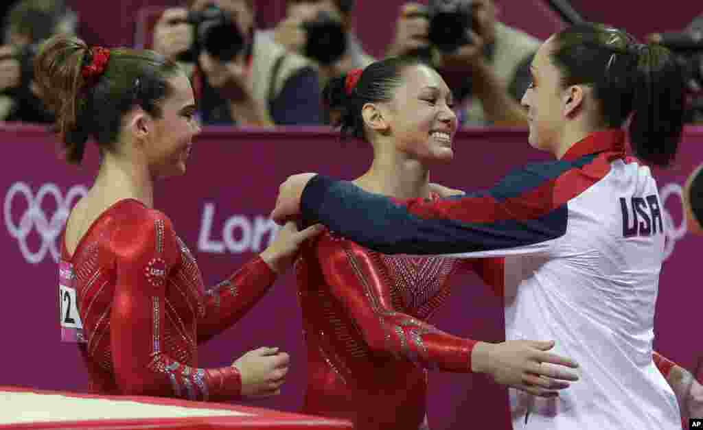 U.S. gymnast Kyla Ross, center, hugs teammate U.S. gymnast Jordyn Wieber during the Artistic Gymnastics women's team final at the 2012 Summer Olympics, July 31, 2012, in London.
