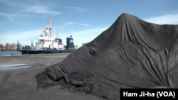 FILE - North Korean coal is shown after being unloaded at the Port of Pohang, South Korea.