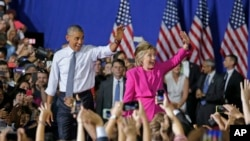 President Barack Obama and Democratic presidential candidate Hillary Clinton wave to the crowd during a campaign rally for Clinton in Charlotte, N.C., July 5, 2016.