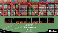 FILE - China Shipping containers sit on a ship in the Port of Los Angeles after being imported to the U.S., California, Oct. 7, 2010.
