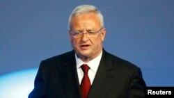 FILE - Volkswagen CEO Martin Winterkorn gives his closing speech during the Volkswagen group night ahead of the Frankfurt Motor Show (IAA) in Frankfurt, Germany, Sept. 14, 2015.