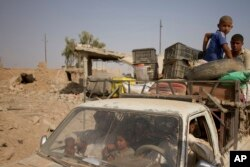Civilians flee villages outside Mosul a day after Iraqi Kurdish forces launched an operation east of the Islamic State-held city in Iraq, Aug. 15, 2016. The Kurdish forces known as the Peshmerga say they have retaken 12 villages in the operation in an effort to encircle the city.