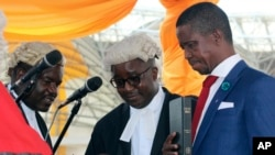 FILE - Edgar Lungu, right, is sworn in as president at an inauguration ceremony in Lusaka, Jan. 25, 2015.