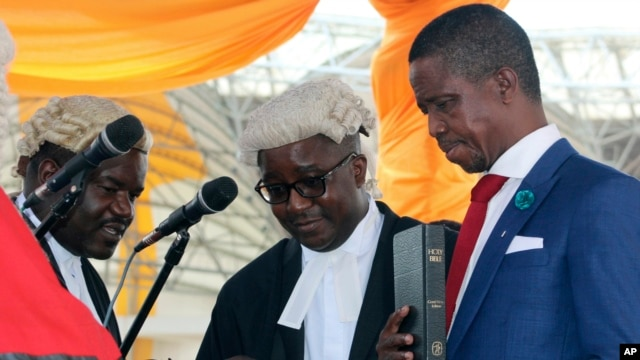 FILE - The Patriotic Front's Edgar Lungu, right, is sworn in as president at an inauguration ceremony in Lusaka, Jan. 25, 2015. Lungu says he will nominate a female vice presidential running mate for his re-election bid in the August 11, 2016, general election.