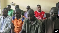 Men believed to be members of Islamist sect Boko Haram and suspected of being involved in a series of bomb attacks wait for the start of a court session at the Wuse magistrate court in Abuja, September 13, 2011.
