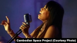 Lead singer Channthy Kak performs with Cambodian Space Project