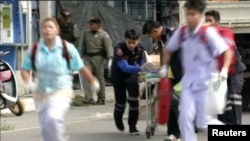 Rescuers and medical officers push an injured person on a gurney at the site of a bomb blast in Hua Hin, south of Bangkok, Thailand, in this still image taken from video, August 12, 2016.