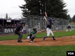 Timberline High School players in Lacey, Washington, used the axe bat in warmups, but stayed with the traditional bats for the actual game. (T. Banse/VOA).
