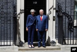 Britain's Prime Minister Theresa May greets Israeli Prime Minister Benjamin Netanyahu in Downing Street, London, June 6, 2018.