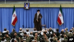 FILE - Iranian Supreme Leader Ayatollah Ali Khamenei gestures during a meeting with commanders of the paramilitary division of the elite Revolutionary Guard in Tehran, Nov. 25, 2015.