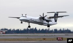 A Bombardier Dash 8 operated by Alaska Airlines Horizon Air takes off on Jan. 26, 2016, at Seattle-Tacoma International Airport in Seattle.