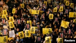 """Anti-extradition bill protesters attend a rally calling on the British and U.S. governments to monitor the implementation of """"one country two systems"""" principal, in Hong Kong, China August 16, 2019."""