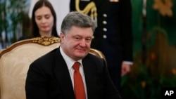 FILE - Ukraine's President Petro Poroshenko is seen in a meeting with Singapore's President Tony Tan, Tuesday, Dec. 9, 2014.