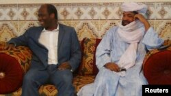 Iyad Ag Ghali, right, leader of Ansar Dine, meets with Burkina Faso foreign minister Djibril Bassole in Kidal, northern Mali, August 7, 2012.